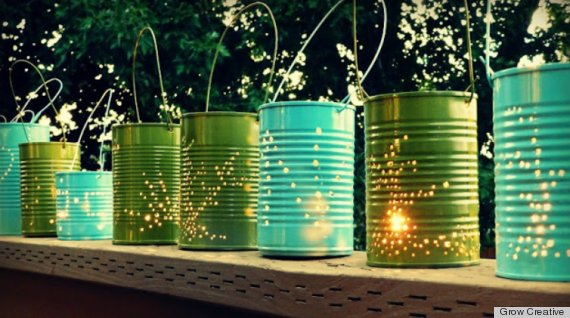 DIY candle holders made from old tin cans painted green and turquoise