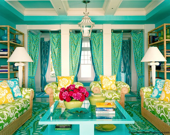 Teal living room with yellow, green and blue chairs