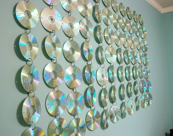 A wall of CDs used to decorate a light blue wall