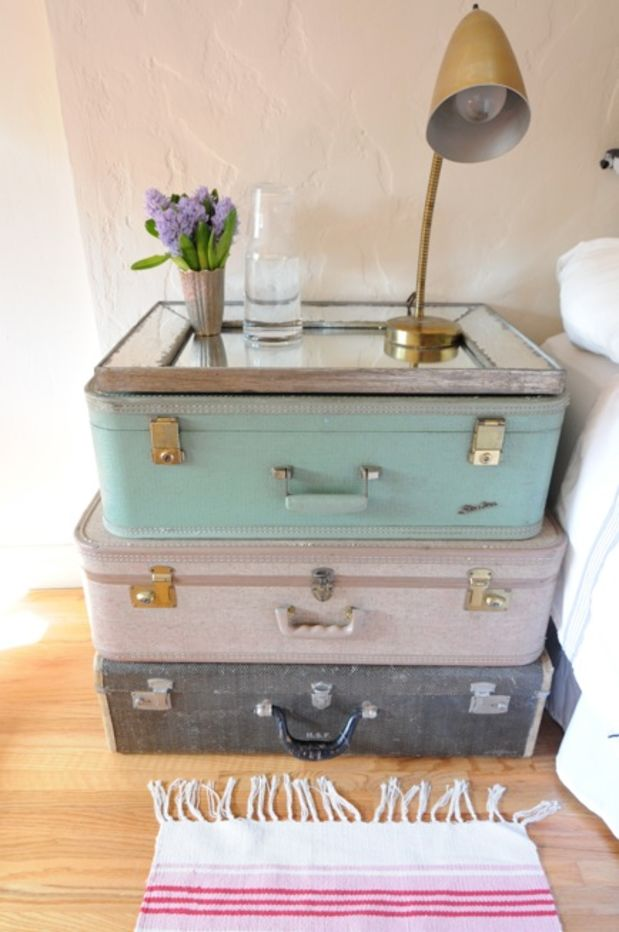DIY vintage suitcases stacked as a table