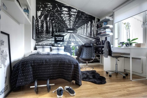 Small black and white bedroom with wall decal of perhaps Brooklyn bridge