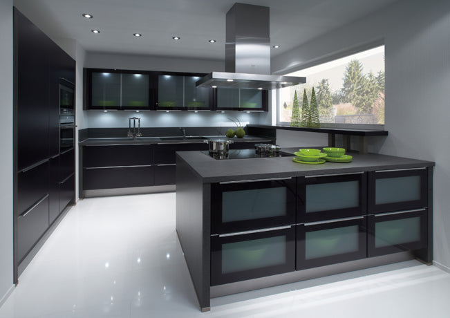 Grey and black kitchen with white floor and overhead silver extractor fan