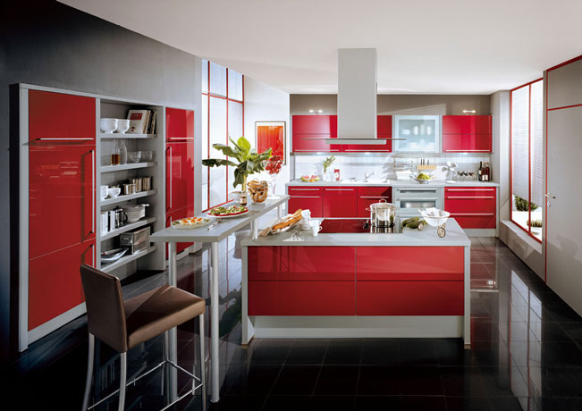 Red, grey and white modern kitchen with island oven and breakfast bar