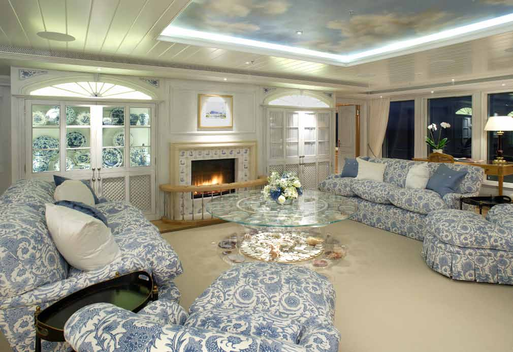 Cream living room with blue and white sofas and a sky and cloud ceiling mural