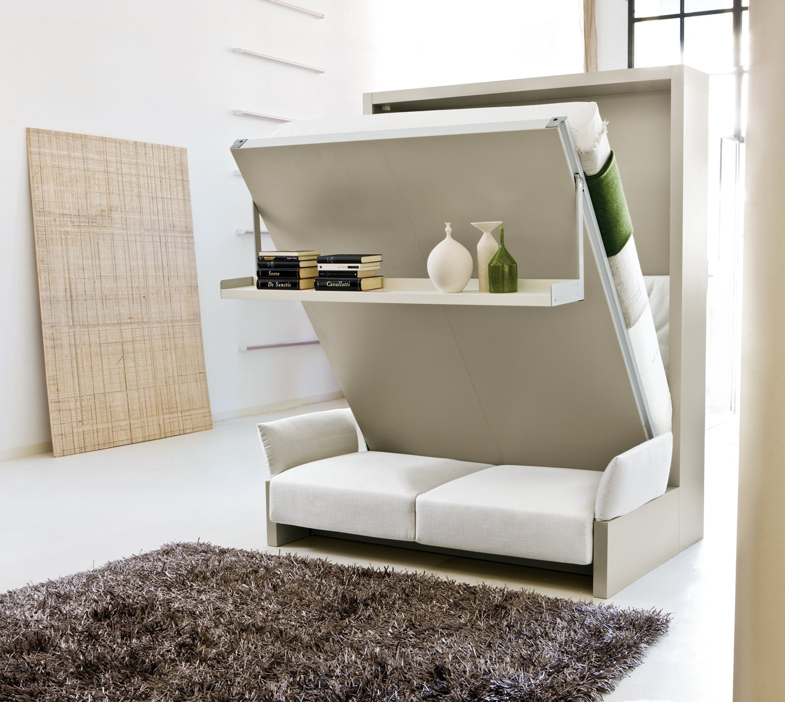 Space saving fold out bed and sofa combination in cream