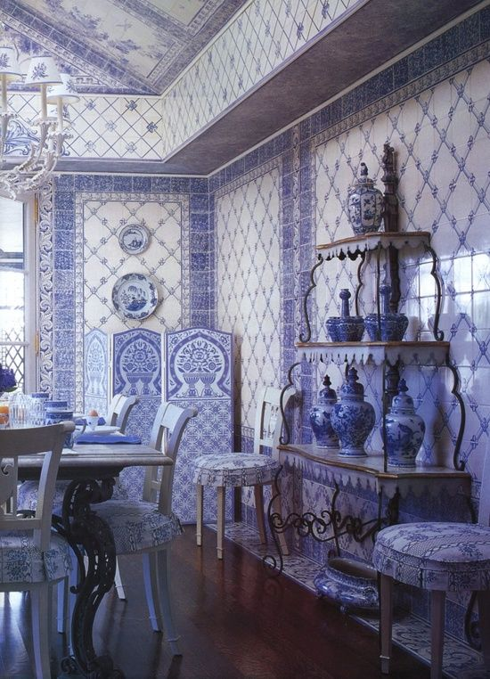 Very blue and white room, with traditional blue and white wall tiles, bone china and matching dining table and dining chairs
