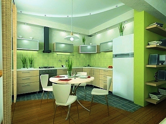 Light green kitchen, with a small round breakfast table in the middle