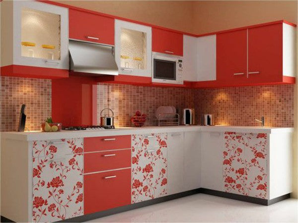 White and orange kitchen with floral orange pattern on the unit doors