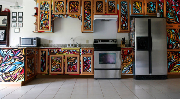Funky modern kitchen with swirling colourful doors