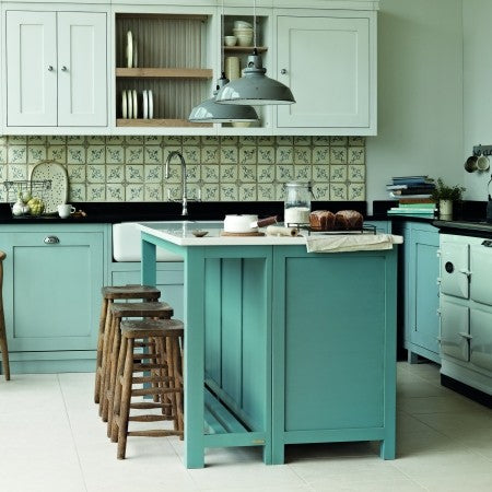 Traditional yet stylish duck egg blue and light mint green kitchen with an arger oven