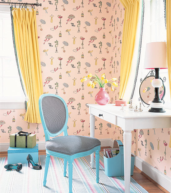 Light salmon wallpaper with cute kids pattern, white dressing table and blue chair