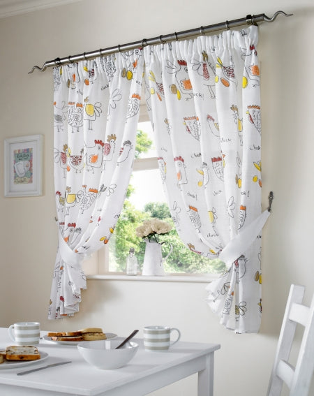 White kitchen curtains with a red, beige, orange and yellow cartoon chicken pattern