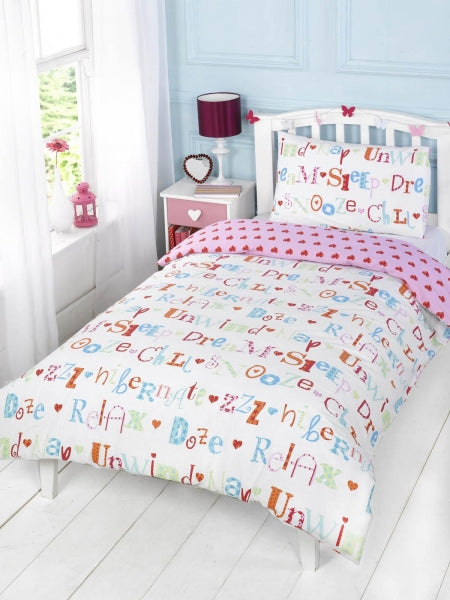 White and pink single bedding with sleep related words on the bedding in funky and fun fonts