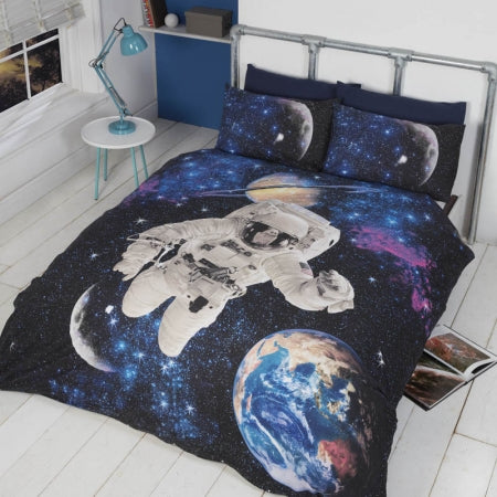 Space themed bedding with an astronaut floating in space, with Earth, the moon and Saturn in the background