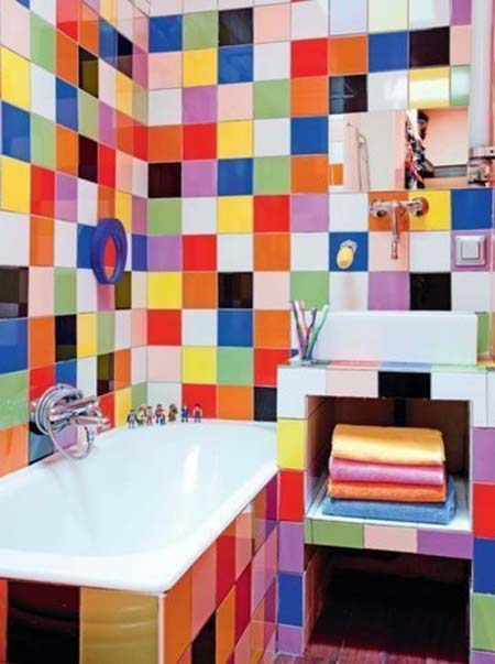 Colourful kids bathroom with wall tiles in lots of different colours