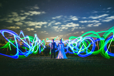Large Glow Sticks Swirled Around For Bride And Groom