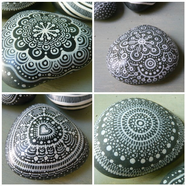 Collage of different grey pebbles adorned with intricate white patterns