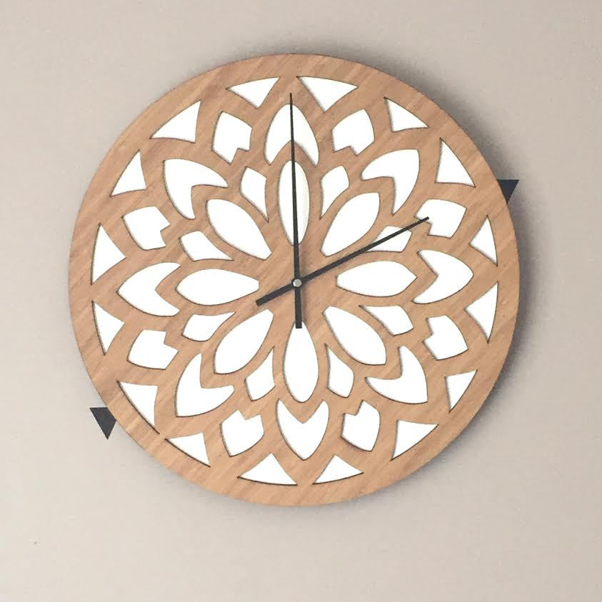 Mandala effect wooden clock with white leaf shapes