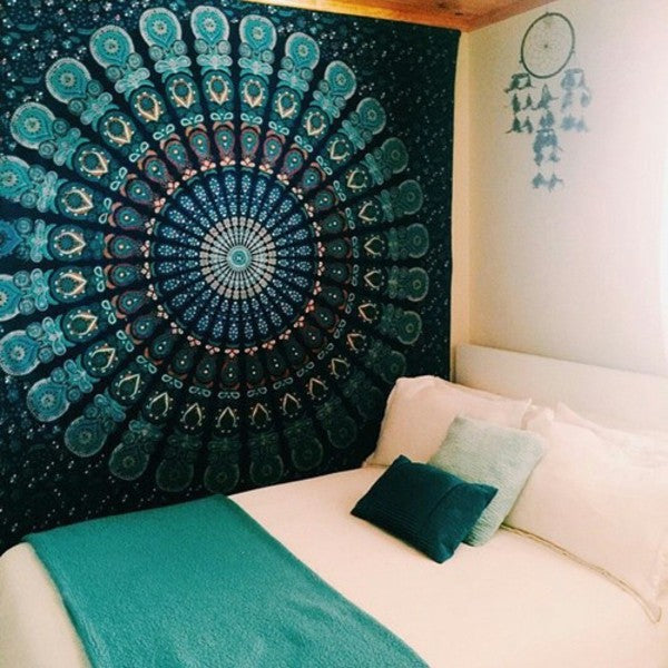 Dark blue and teal intricate round pattern on a wall in a cream bedroom