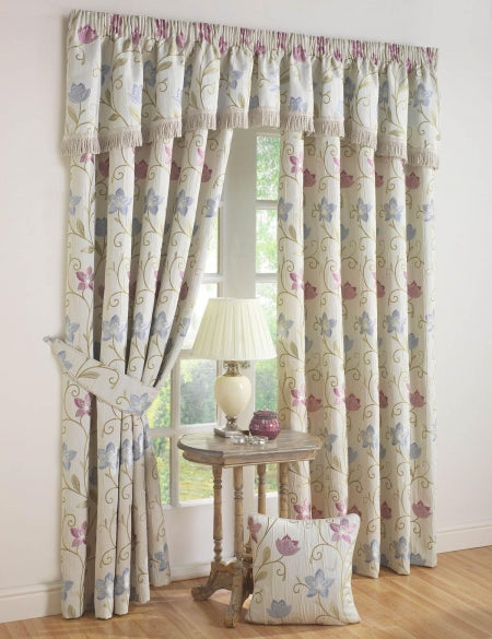 Cream curtains with a light blue and soft purple floral design