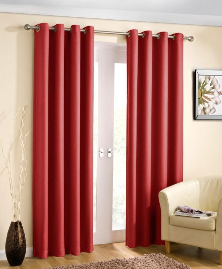 Red eyelet curtains in a cream living room