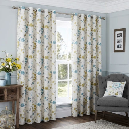 Light blue and cream floral design on a cream eyelet curtain