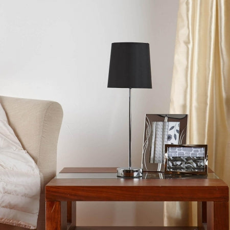 Table lamp on a wooden and glass table