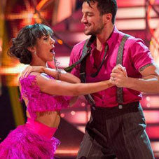 Two Strictly Come Dancing dancers wearing pink, including Peter Andre