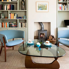Cream and light blue living room with glass coffee table