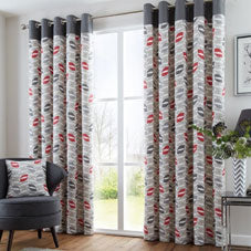 Grey, white and red geometric curtains at a window