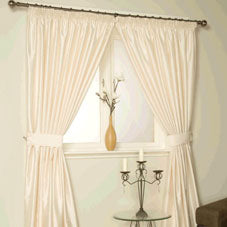 Cream and white living room, with cream pencil pleat curtains
