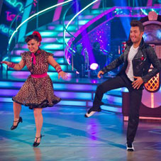 Two dancers from Strictly Come Dancing, doing a Rock & Roll Jive