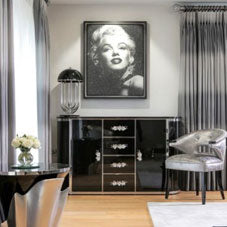 Black and white living room with photo of Marilyn Monroe on the wall