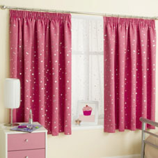Pink spotted curtains in a cream and pink bedroom