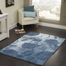 A dark blue rug with a floral embossed pattern