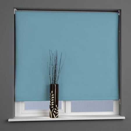 Blue ready made roller blind in a window
