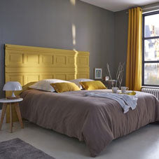 A dove grey bedroom with hints of yellow