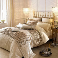 gold, beige and cream luxury double bedding on a bed