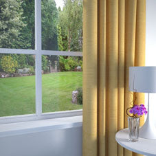 Yellow made to measure curtains at a window