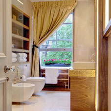A beige and cream bathroom with hints of yellow and gold