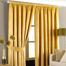 Yellow pencil pleat curtains at a window