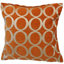 Orange cushion covered in gold circles