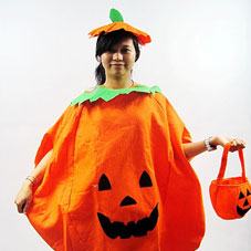 Young girl dressed in a orange pumpkin costume