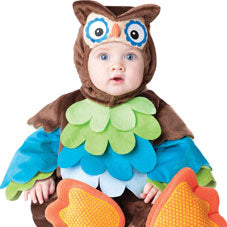 Young baby dressed in a cute owl costume