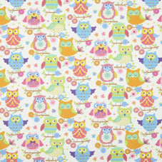 Cream fabric with a cut owl pattern in orange, pink, blue and light green