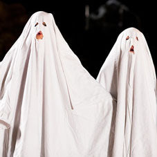 White bed sheets used as a ghost costume