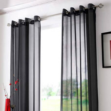 Black voile curtains at a window