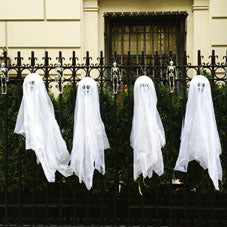 White ghost decorations stuck onto black metal railings