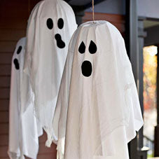 White towel ghosts hung at a front door porch
