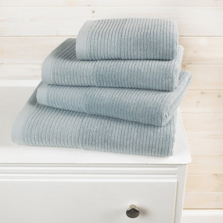 Towels stacked on a white set of drawers